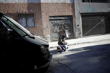 A member of the security forces detains a protester during a protest against Chile's government in Santiago