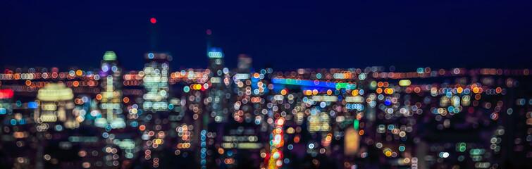Abstract urban night light bokeh defocused background. Fototapete