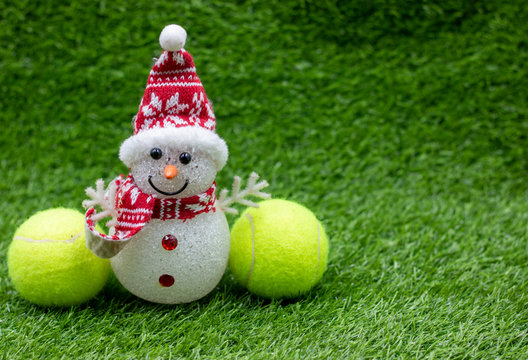 Tennis Christmas Holiday with Santa Claus on green grass with tennis ball