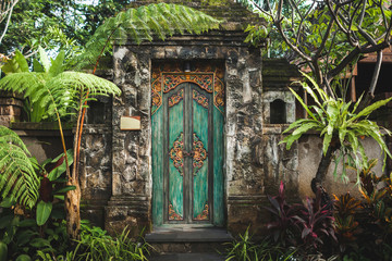 Self adhesive Wall Murals Bali Traditional balinese handmade carved wooden door. Bali style furniture with ornament details. Old and vintage local style of architecture in Bali. Handmade details.