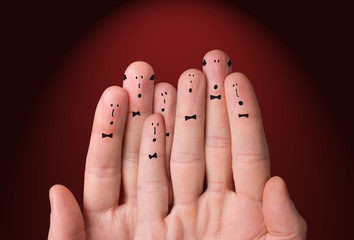 Faces are painted on the fingers. Choir singing together. Cheerful fingers depict a classic choir
