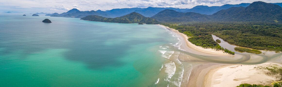 Aerial view panorama of Green Coast shoreline with turquoise water, beach, river and green mountains, Brazil