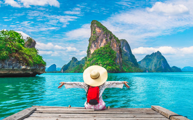 Traveler woman joy fun relaxing on wood bridge looking beautiful destination island, Phang-Nga bay, Travel adventure Thailand, Tourism natural scenic landscape Asia, Tourist on summer holiday vacation