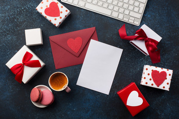 Valentine's day blank greeting card, coffe and gift. Office workplace