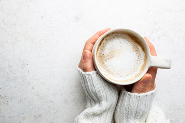 Foto auf Leinwand Kaffee Cup of coffee in womens hand on white background, top view