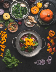 Cooking of seasonal vegetarian meals for autumn and winter with pumpkin,spinach, ginger, onion. Top view. Healthy food concept.
