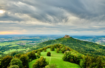 Hilltop Hohenzollern Castle on mountain top in Swabian Alps, Baden-Wurttemberg, Germany