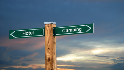 Tuinposter Kamperen Street Sign to Camping versus Hotel