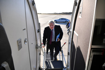 Britain's Prime Minister Boris Johnson boards a plane at Doncaster Sheffield Airport in Doncaster