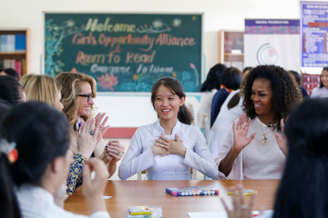 U.S. actor Julia Roberts and former first lady Michelle Obama attend the Girls Opportunity Alliance program with Room to Read at the Can Giuoc Highschool in Long An province