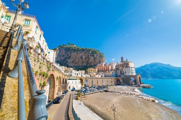 Wide angle view of road leading along coast to small town Atrani in province of Salerno, Campania region, Italy.