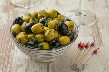 Bowl with green and black olives close up Wall mural