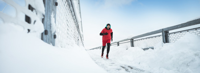 Sport, Winter. Male athlete running.