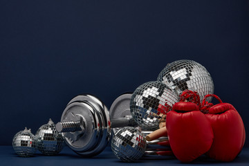 Sports equipment and mirror balls. Fitness New Year and Christmas background