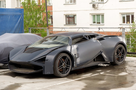 Novosibirsk, Russia - 05.28.2018: Marussia B3 front view. Photography of a Russian supercar SUV on parking. Car after crash.