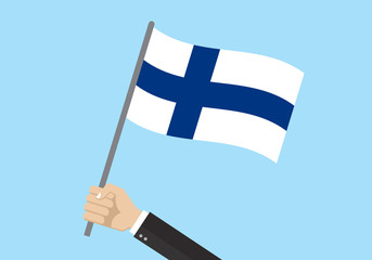 Finland waving flag. Hand holding Finnish flag. National symbol. Vector illustration.