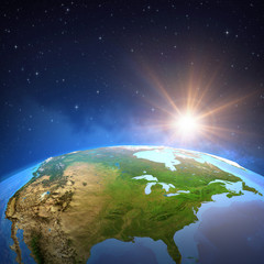 Wall Mural - Sun shining over the Earth from space