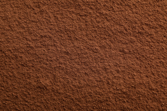 Cocoa powder textured background, close up and space for text