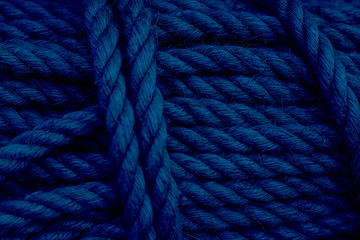 Photo Stands Ship Rough Cord made from natural plant fiber. Rope detail, closeup. Wallpaper, background about fabtic manufacture, eco friendly material. Horizontal. Selective focus Classic, blue monochrome, trend 2020
