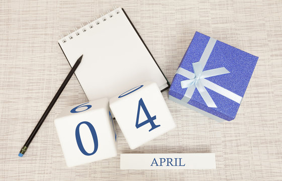 Calendar with trendy blue text and numbers for April 4 and a gift in a box.