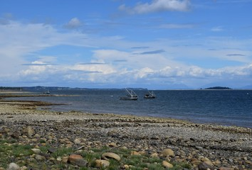 two oyster fishing boats anchored side by side in the ocean