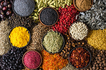 Fototapete - Indian spices and herbs as background for packing labels with food.