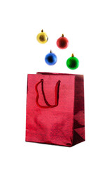 Red  paper shiny gift bag and christmas balls.