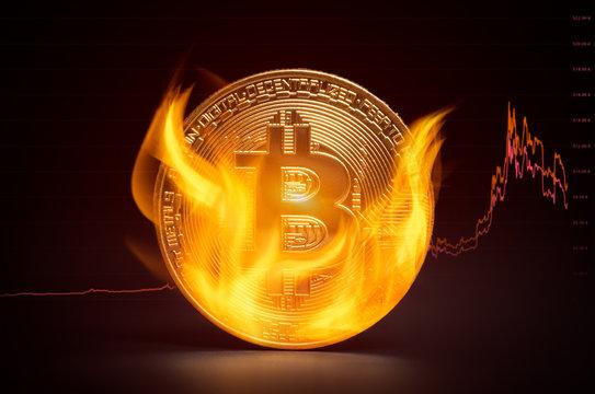 Golden bitcoin burning in flames