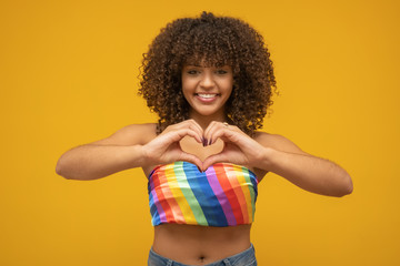 Young curly hair woman lgbt. Alone. Beautiful afro young happy woman with symbol of the LGBT Human Rights, Equality, LGBT Wall mural