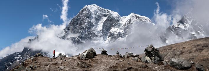 Woman trekking Thokla Pass with Nuptse in background, Himalayas, Solo Khumbu, Nepal