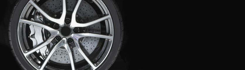 Alloy wheel with disk brake and calliper of modern luxury sport car.