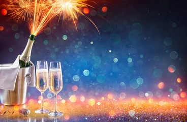 New Year Celebration With Champagne And Fireworks Popping In Bottle  - Colors Trend 2020