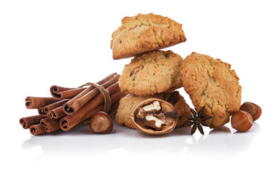 Homemade cookies with cinnamon nuts and spice. Still life of sweets and baking. Isolated on white background.