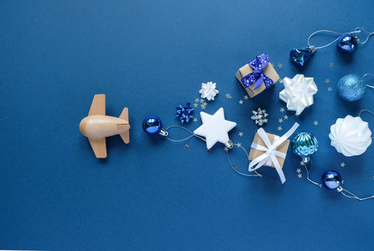wooden children's plane on a classic blue background