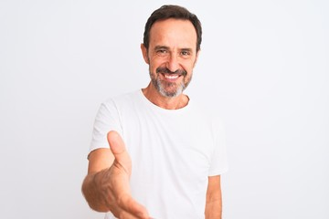 Middle age handsome man wearing casual t-shirt standing over isolated white background smiling...
