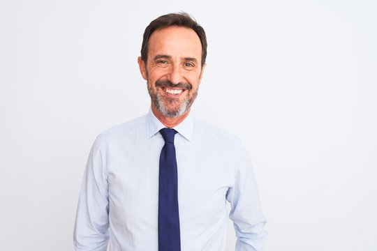 Middle age businessman wearing elegant tie standing over isolated white background with a happy and cool smile on face. Lucky person.