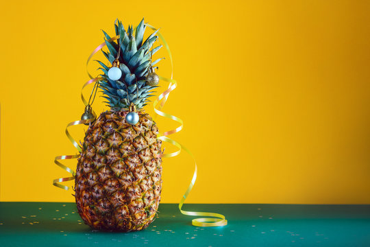 Pineapple decorated with serpentine and balls, holidays christmas and new year concept