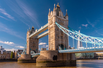 The tower Bridge in a sunny day in London with the shard and thames