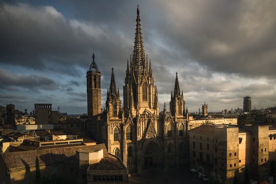 Barcelona cathedral seen from across the courtyard  at sunset, with cloudy skies