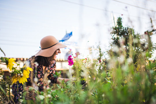 happy woman picking flowers in the garden