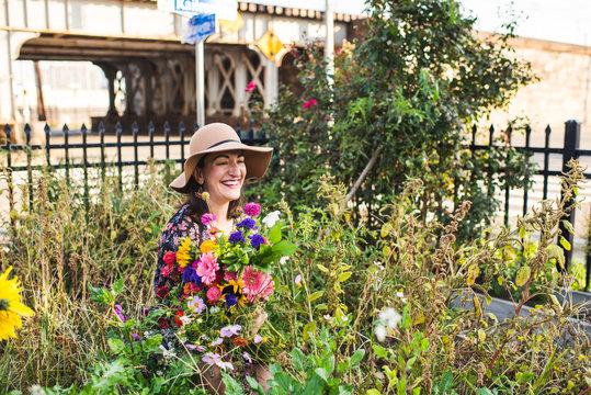 happy woman in an urban garden