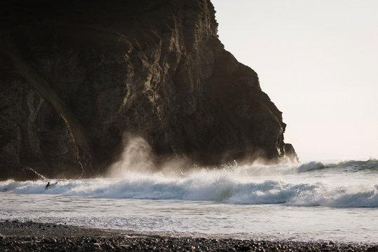 Cornish Coastline Surfer Entering Waves