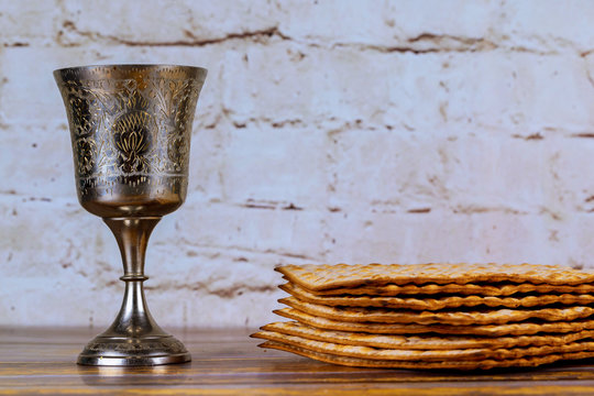 A Jewish Matzah bread with wine in Kiddush cup. Passover holiday concept