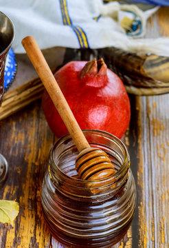 Honey jar and fresh ripe apples. Jewesh new year symbols. Rosh hashanah