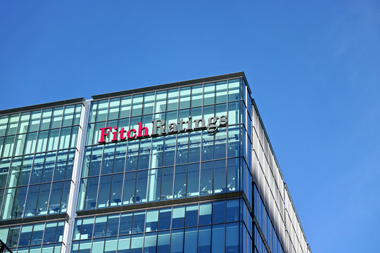 London, United Kingdom - February 03, 2019: Fitch Ratings logo signage at top of their Headquarters in UK (other is in New York), Canary Wharf. FR is one of the Big Three credit rating agencies