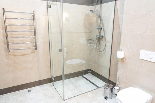 Glass shower walk in cabin in modern interior