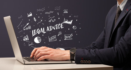 Businessman working on laptop with LEGAL ADVICE inscription, modern business concept