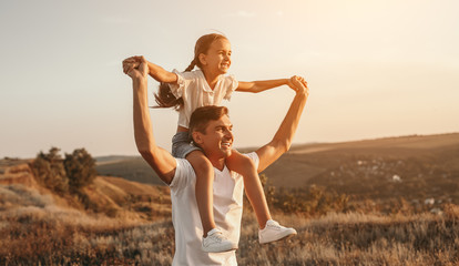 Father and daughter enjoying freedom in nature Fotomurales