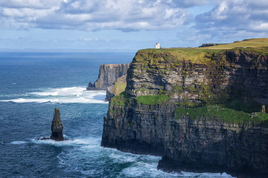 The famous Cliffs of Moher, tourist viewing location of spectacular sea cliffs in the Burren region of County Clare, Ireland. O'Brien's Tower visible.