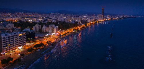 Keuken foto achterwand Cyprus Aerial view of Limassol promenade or embankment with alley and buildings in Cyprus at night. Drone photo of mediterranean sea resort Limassol from above.